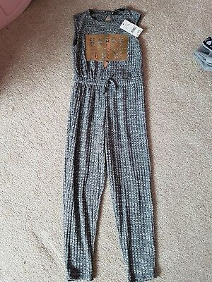 girls jumpsuit 6-7 new with tags