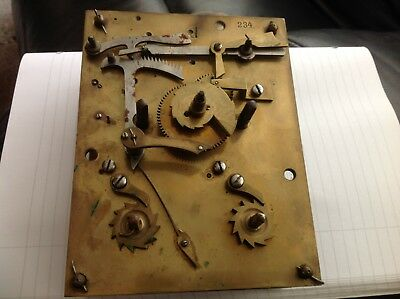 Antique W.H. Clock workings stamped 234
