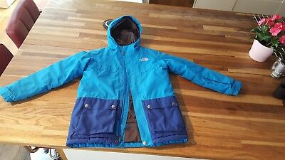 Warm padded blue boys North Face jacket in great condition age 10-12 years