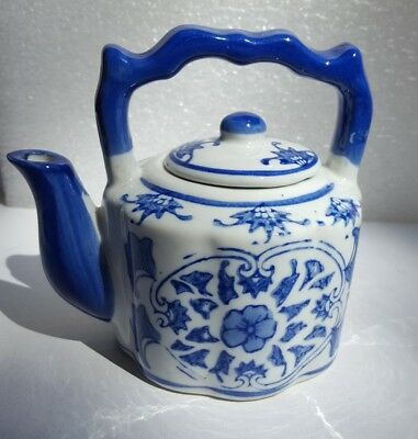 Antique Japanese blue-and-white porcelain teapot, signed