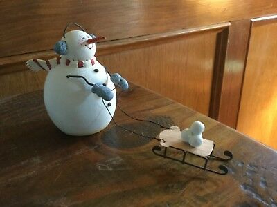 "Sandi Gore Evans Snowman, snowboy, pulling sled with snowballs. 6.50"" long. CUTE"