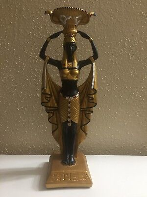 Golden carved Ancient Egyptian Statue Winged Goddess Isis for Protection Egypt