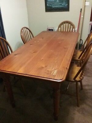 Used wooden dining table and 6 chairs