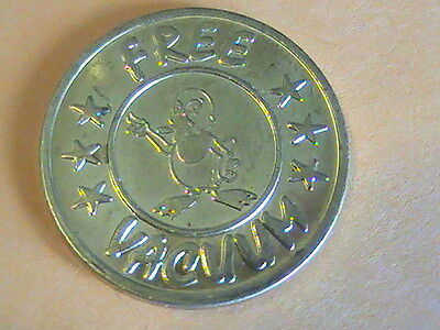TOKEN CAR WASH TOKEN: CARisma CAR WASH / FREE VACUUM / 22mm BRASS