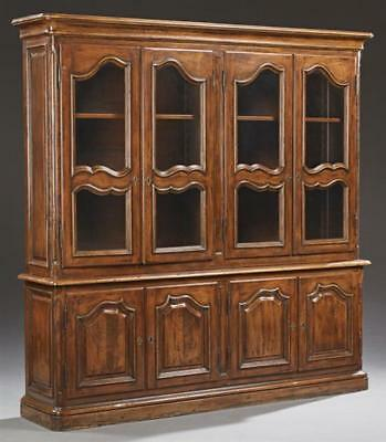 French Provincial Louis XV Style Carved Cherry Bookcase, 19th c., the... Lot 433