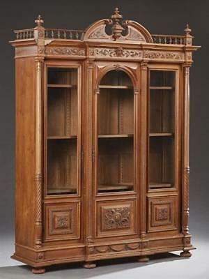 French Louis XVI Style Carved Walnut Bookcase, 19th c., with a broken ... Lot 82