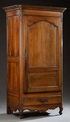 French Louis XV Carved Walnut Armoire, 19th c., the stepped rounded c... Lot 213
