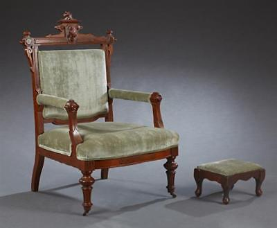 American Victorian Carved Walnut Armchair, c. 1880, the arched crest ... Lot 282
