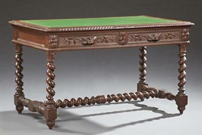 French Henri II Style Carved Oak Desk, 19th c., the inset green baize... Lot 150