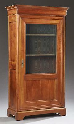 French Louis Philippe Style Carved Cherry Bookcase, c. 1880, the step... Lot 203