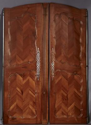 Pair of French Carved Walnut Armoire Doors, c. 1840, the arched tops ... Lot 963
