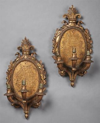 Pair of French Carved Gilt Pine Three Light Sconces, early 20th c., t... Lot 907