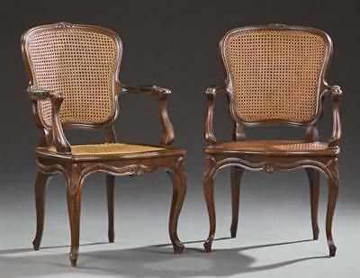 Pair of Louis XV Style Carved Beech Fauteuils, early 20th c., the arc... Lot 678
