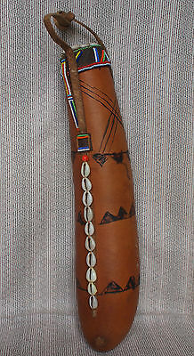 An African masai  tribe cowrie shell decorated milk gourd.