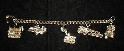 Vintage Caterpillar Tractor Co Gold-tone Bracelet w/ 5 Heavy Equipment Charms
