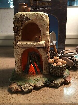 """FONTANINI ITALY 5"""" Lighted Flickering Fireplace in box #56516."""