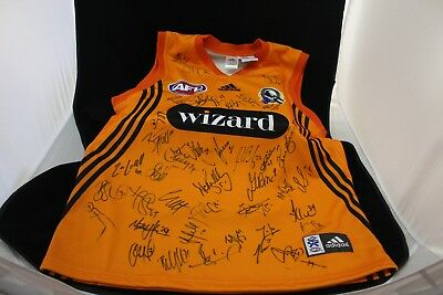 2005 Team Signed Presentation Training Guernsey presented to Wizard Hume Loans.