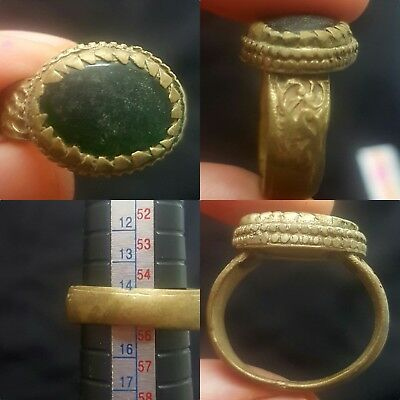 Medieval Gilded ring with green stone insert