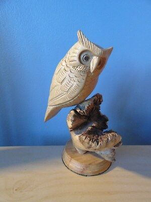 Black Forest type hand carved wooden owl perched on tree stump on ronud mount