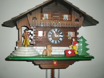 Cuckoo Clock, Lötscher Swiss Made, Animated, All wood Hand Carved Figures.