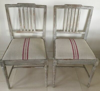 Four antique painted Swedish Gustavian dining chairs