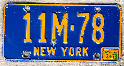 The Old Orange on Blue New York License Plate with a 1973 Sticker