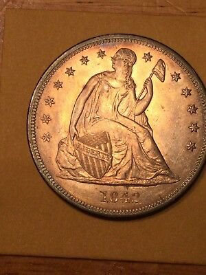 1842 seated Liberty Dollar album toned  high grade. Looks BU