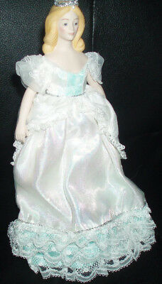 """Porcelain 8"""" tall Avon Doll with Plastic Stand.Painted Shoes. Crown.Ruffled Gown"""