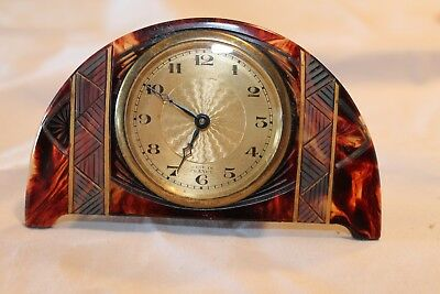 A beautiful Art Deco period faux tortoiseshell travel clock in  working order