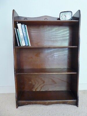 Vintage freestanding wood bookcase made by Spinney with scalloped edges
