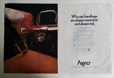1970 Etienne Aigner burgundy purse to page vintage ad as is
