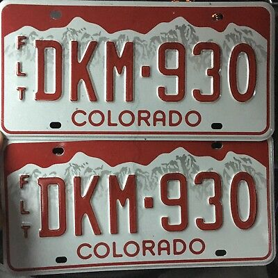Colorado White Mountains with Red Backdrop Fleet License Plate