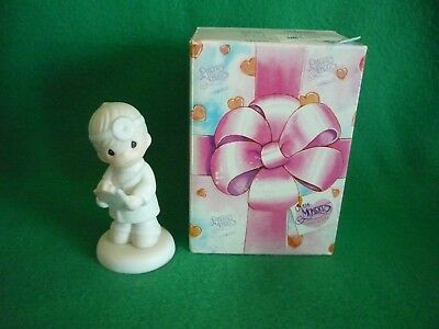 """Precious Moments figurine """"Loving Is Caring"""""""