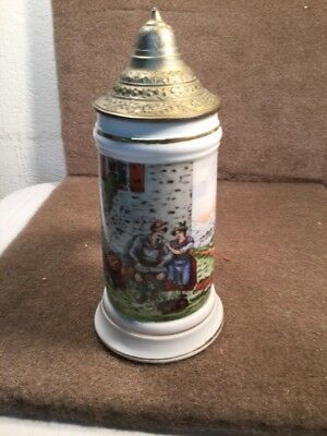 Ceramic Beer stein with a lady in the bottom very rare