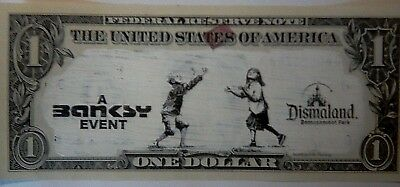 A Banksy original art piece from Dismaland. A Dismaland dollar with documents.