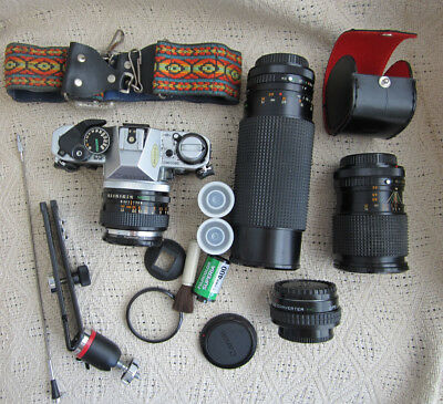 Vintage Canon AE-1 Program Camera with 4 lenses, accessories, and Gemini Bag