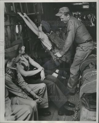 1958 Press Photo Civil Air Patrol Preparing to Parachute Out of Plane