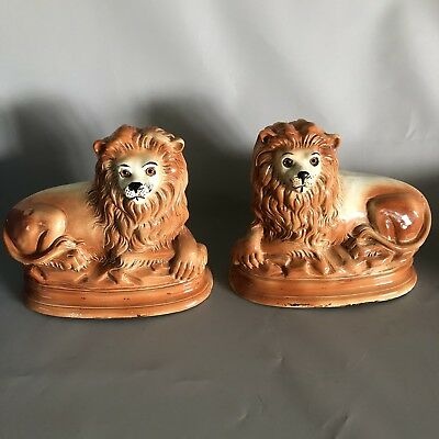 Antique Pair 19th Century Staffordshire Pottery Recumbent Lions with Glass Eyes