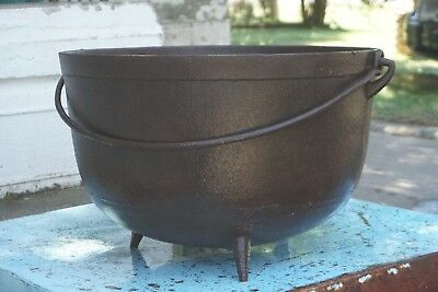 Large antique cast iron cowboy cauldron