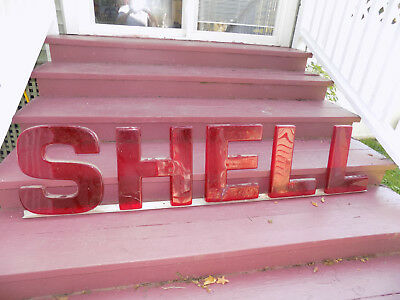 SHELL Oil Letters on metal rail