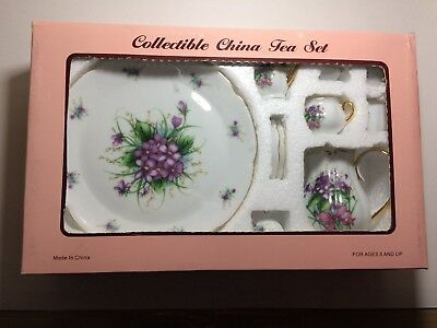 Collectible China Tea Set 10 pieces New in box never Used Purple Flowers