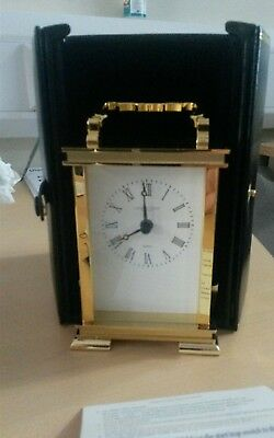 Carriage clock, brass, by The London Clock Company. In real leather case
