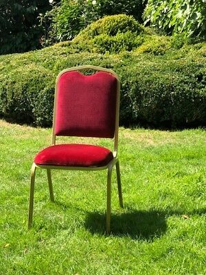60 Banquet Red Chairs available. In good condition. £15 per chair