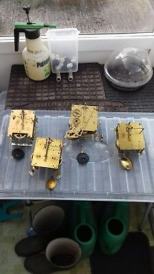 clock mechanism pendulum four  . one Ingersoll .three smiths spares or repair