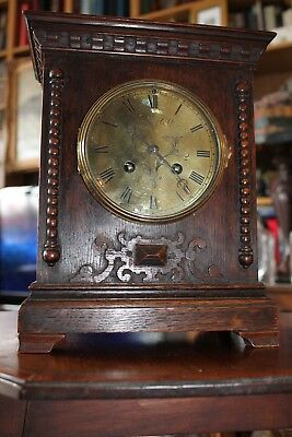A superb quality oak chiming mantle clock by Maple & Co in very good condition.
