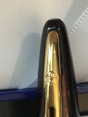 Waterman Carene ball point pen in Marine Amber GT lacquer. 23K gold finishes.