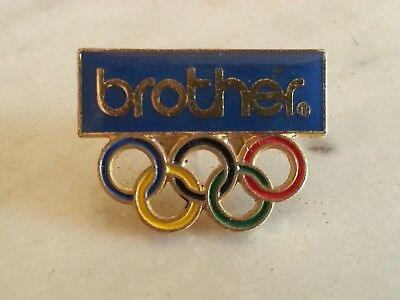 Pin's BROTHER Anneaux Olympiques