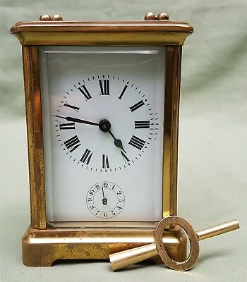 Nice quality antique Carriage Clock with striking Bell underneath