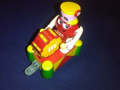 Mars Inc 2006 Red M & M Character Arms Move Towards The Drums On A Train Car
