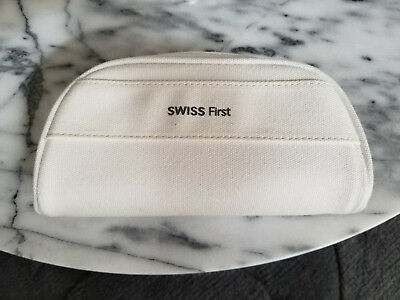 Swiss Airlines First Class amenity kit white canvas bag with eyemask earplugs